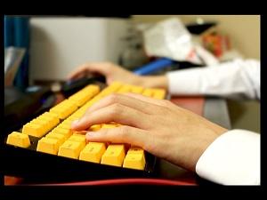 typing on yellow keyboard